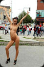 Teen girl is getting naked in the public front of the people.