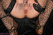 This MILF in leopard stockings has hot pussy.