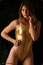 She looks so good in sexy shiny and golden swimsuit.